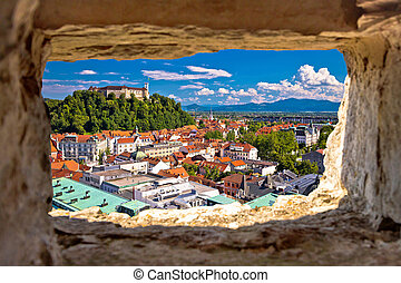 Ljubljana aerial view through stone window