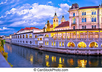 Ljubljana riverfront architecture evening view, capital of Slovenia