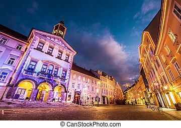Romantic Ljubljana's city center, the capital of Slovenia, decorated for Christmas holidays. City Hall shot at dusk.