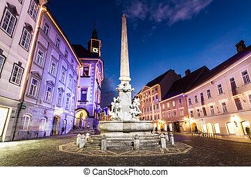Romantic Ljubljana's city center, the capital of Slovenia, decorated for Christmas holidays. City hall and Roba's fountain.