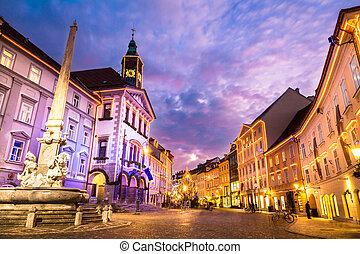 Romantic Ljubljana's city center, the capital of Slovenia, Europe. City hall and Roba's fountain shot at dusk.