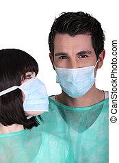 llevando, cirujanos, máscaras, cara