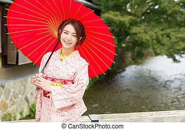 llevando, mujer, kimono