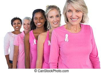 llevando, rosa, cáncer, alegre, pecho, cintas, mujeres