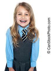 llevando, uniforme de la escuela, niña, excitado, fierros