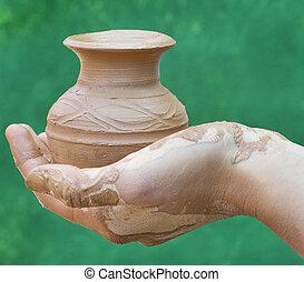 llevar a cabo la mano, alfarería, primer plano, tarro