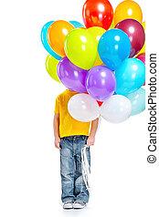 Llittle boy hiding behind balloons