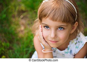 Llittle girl child outdoor in summer day.