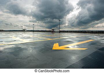 lluvioso, estacionamiento
