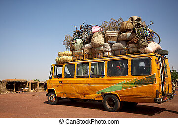 Loaded African min van - Over loaded mini van on a road in...