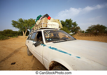 Loaded African taxi - Over loaded taxi on a road of Mali