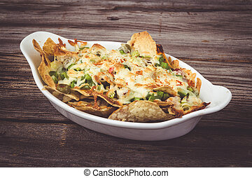 loaded cheese nachos with olive pepper and salsa