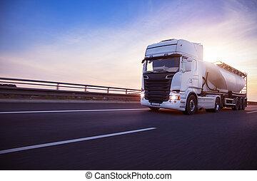 Loaded European truck tank on motorway