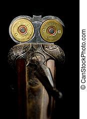 Loaded shotgun - Two shotshells in a chamber of side-by-side...
