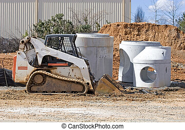 Loader and Concrete Pipe