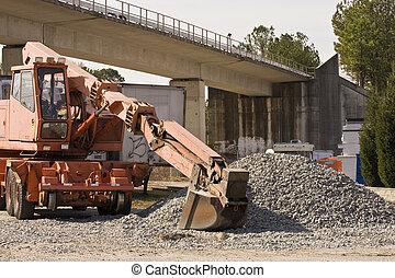 Loader and Gravel Under Bridge
