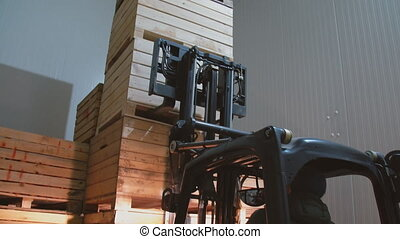 loader carries large boxes - the loader carries large crates...