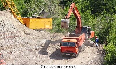loader dump tipper loads of sand