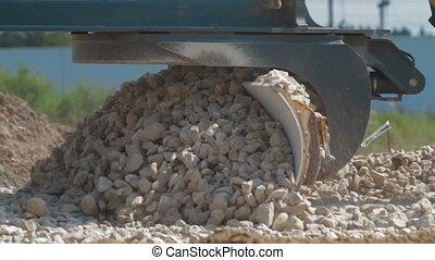 Loader excavator at road construction work - Closeup loader...