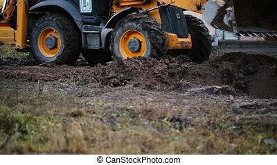 Loader excavator at road construction work.