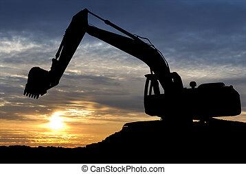 Loader excavator over sunset - silhouette of Excavator...