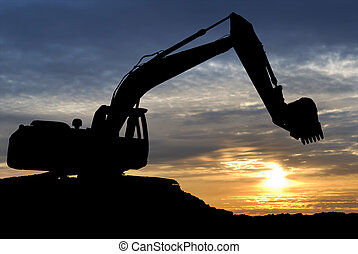 Loader excavator over sunset - silhouette of Excavator...