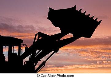 loader shovel silhouette - silhouette of risen loader...