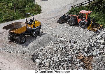 Loader small bulldozer moving at construction area