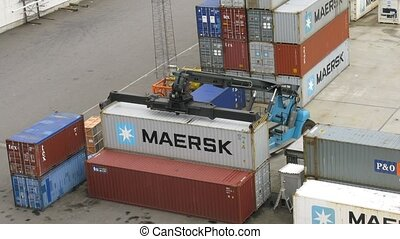 Loader vehicle stack containers in Bergen, Norway