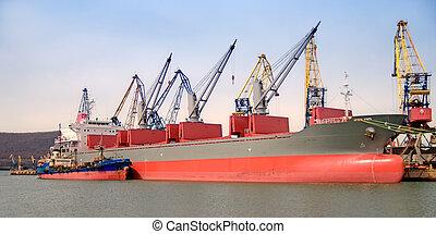 Loading a cargo ship.