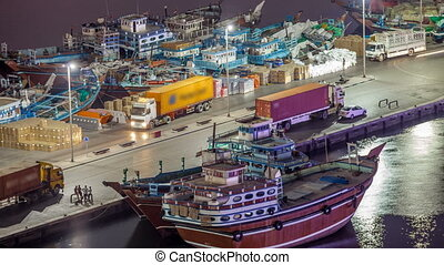 Loading a ship in Port Said night timelapse in Dubai, UAE.