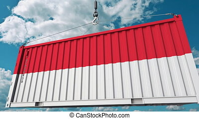 Loading cargo container with flag of Indonesia. Indonesian...
