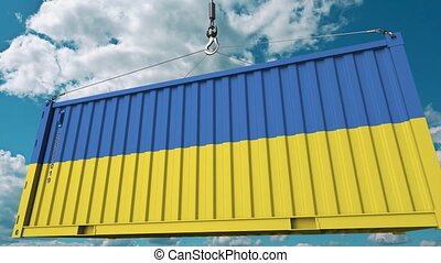 Loading cargo container with flag of Ukraine. Ukrainian...
