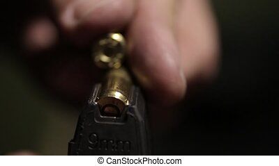 Loading cartridge with 9mm bullets - Cartridge with 9mm...