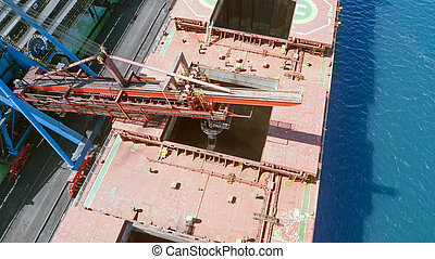 loading coal into the hold of the vessel