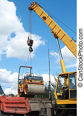 Loading compactor on the transportation machine using a ...