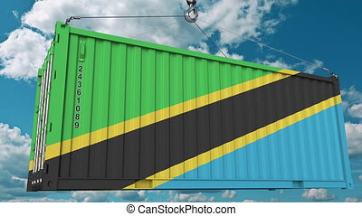 Loading container with flag of Tanzania. Tanzanian import or...