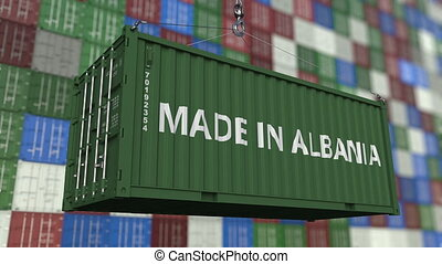Loading container with MADE IN ALBANIA caption. Albanian...