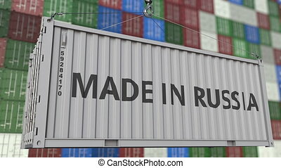 Loading container with MADE IN RUSSIA caption. Russian...