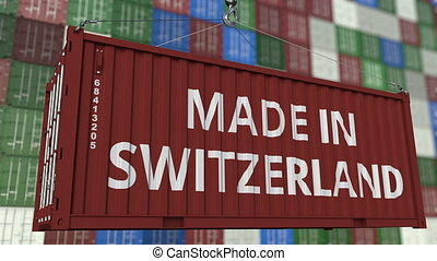 Loading container with MADE IN SWITZERLAND caption. Swiss...