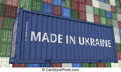 Loading container with MADE IN UKRAINE caption. Ukrainian...