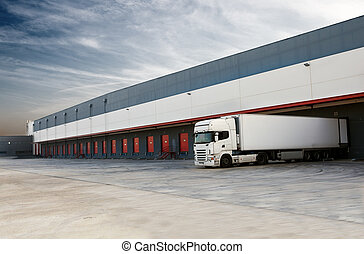 Industrial image of loading docks and truck