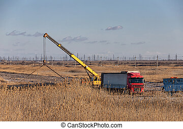 Loading of large-diameter steel pipes in the steppe using a truck crane