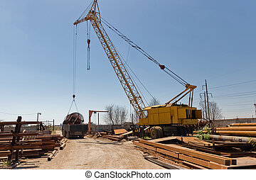 Loading of large metal structures on the truck with a crane