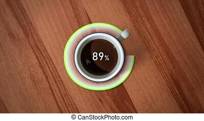 Loading process with the cup of coffee rotating