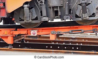 Loading the ballast tamper