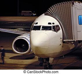 Loading the plane - Passenger jet plane loading the people...