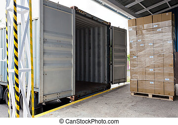 Loading the truck - Forklift with carton boxes loading the...