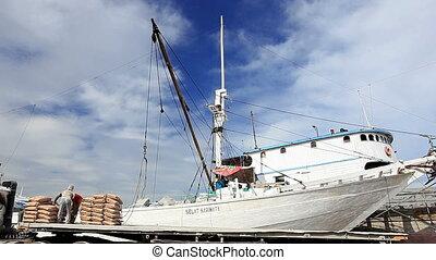 Loading wooden ship