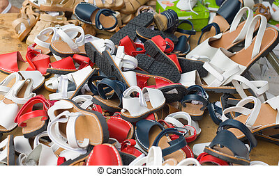 Loads of children shoes on a street market stall